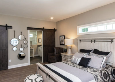 Southampton model master bedroom with barn door