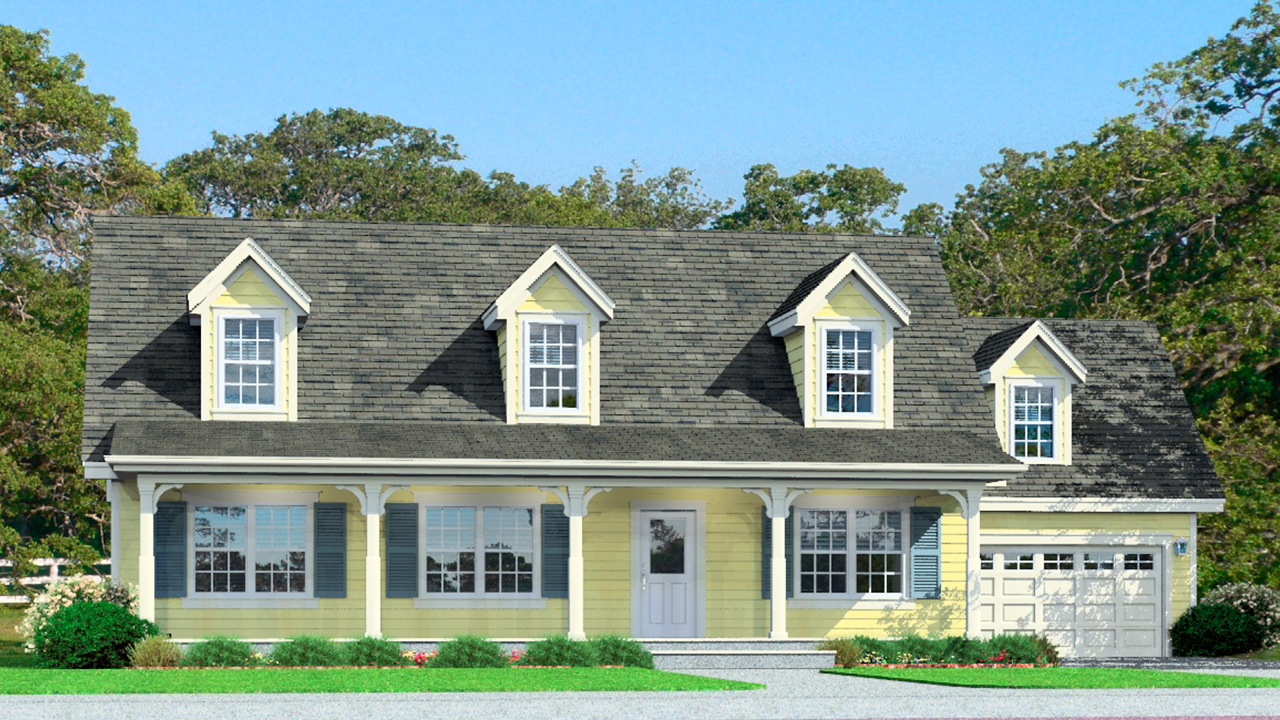 Cape cod modular home with yellow exterior